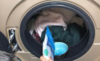 有扣子的衣服能放洗衣机吗