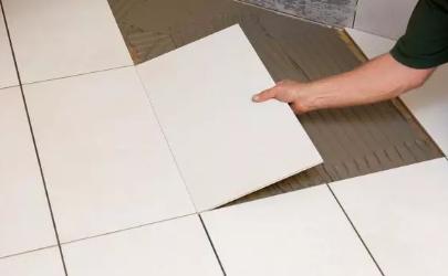 瓷砖拱起来是什么原因